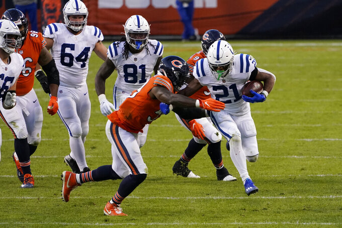 Indianapolis Colts' Nyheim Hines (21) tries to get past Chicago Bears' Danny Trevathan (59) during the second half of an NFL football game Sunday, Oct. 4, 2020, in Chicago. (AP Photo/Charles Rex Arbogast)