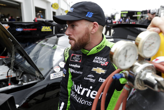 Ross Chastain watches his crew make adjustments to his car after a NASCAR auto race practice at Daytona International Speedway, Saturday, Feb. 9, 2019, in Daytona Beach, Fla. (AP Photo/John Raoux)