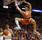 "FILE - In this Feb. 2, 2019, file photo, Texas forward Jaxson Hayes (10) dunks the ball over Iowa State guard Nick Weiler-Babb, left, during the first half of an NCAA college basketball game, in Ames, Iowa. Hayes is the latest one-and-done big man at Texas. Texas announced Thursday, April 11, 2019, the freshman forward will hire an agent and enter the NBA draft, as his meteoric rise from high school bench player barely three years ago into a projected early first-round draft pick this summer continues. ""I have always dreamed about playing in the NBA,"" Hayes said. (AP Photo/Charlie Neibergall, File)"