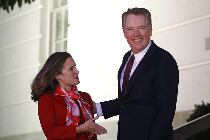 Canadian Deputy Prime Minister Chrystia Freeland, left, is welcomed by U.S. Trade Representative Robert Lighthizer as she arrives at the U.S. Trade Representative's office for talks on the U.S.-Mexico-Canada agreement on trade, Wednesday, Nov. 27, 2019, in Washington. (AP Photo/Patrick Semansky)