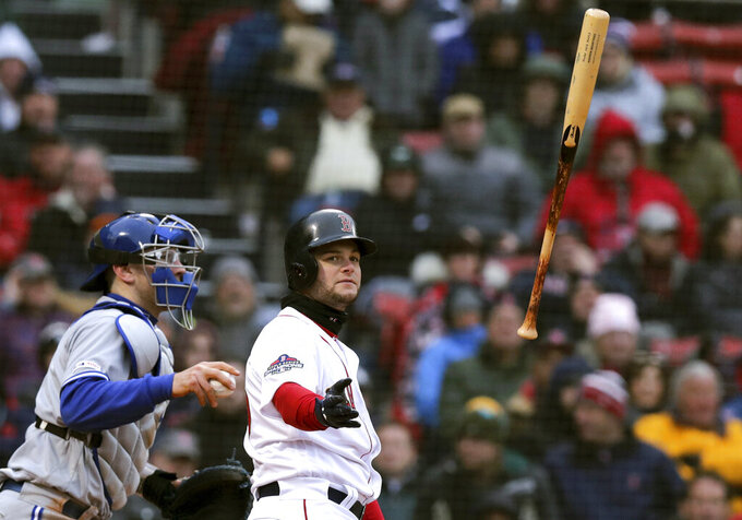 Boston Red Sox's Andrew Benintendi tosses his bat after striking out to end the seventh inning of the home opener baseball game against the Toronto Blue Jays, Tuesday, April 9, 2019, in Boston. At left is Blue Jays catcher Danny Jansen. (AP Photo/Charles Krupa)