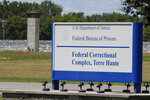 The entrance to the federal prison in Terre Haute, Ind., is shown Monday, July 13, 2020. Daniel Lewis Lee, a convicted killer, was scheduled to be executed at 4 p.m. He was convicted in Arkansas of the 1996 killings of gun dealer William Mueller, his wife, Nancy, and her 8-year-old daughter, Sarah Powell. (AP Photo/Michael Conroy)