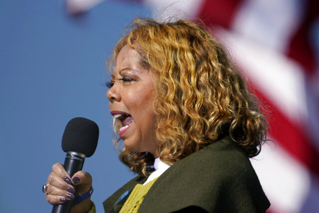 Rep. Lucy McBath, D-Ga., speaks to Biden supporters as they wait for former President Barack Obama to arrive and speak at a rally as he campaigns for Democratic presidential candidate former Vice President Joe Biden, Monday, Nov. 2, 2020, at Turner Field in Atlanta. (AP Photo/Brynn Anderson)