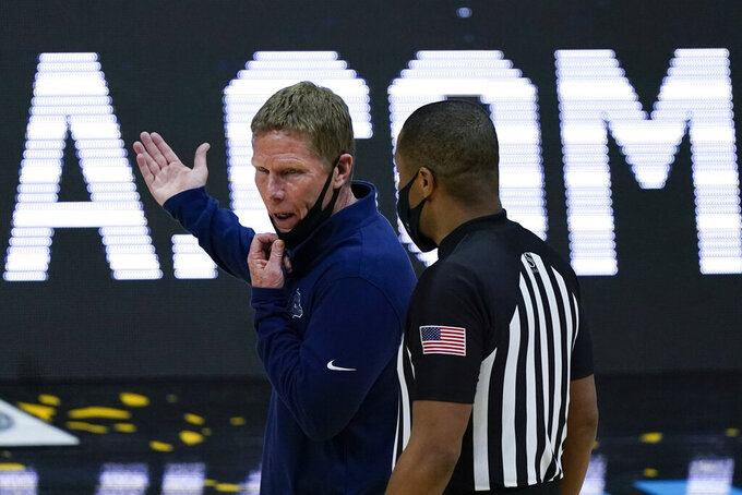 Gonzaga head coach Mark Few questions a call during the first half of the championship game against Baylor in the men's Final Four NCAA college basketball tournament, Monday, April 5, 2021, at Lucas Oil Stadium in Indianapolis. (AP Photo/Michael Conroy)