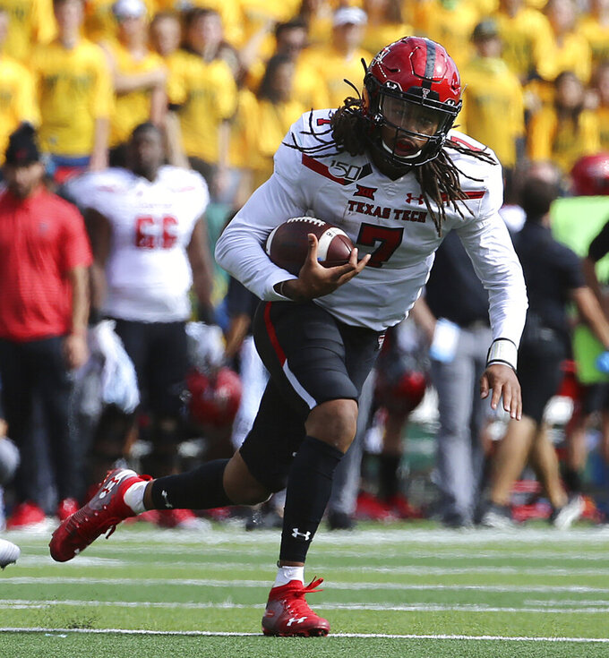 Texas Tech quarterback Jett Duffey (7) runs against Texas Tech during the first half of a NCAA college football game in Waco, Tex.,Saturday, Oct. 12, 2019.(AP Photo/Jerry Larson)