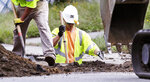 Utility contractors dig up the road above natural gas lines along Dracut Street in Lawrence, Mass., Thursday, Sept. 20, 2018. Nearly 9,000 homes and businesses may be without gas for weeks as investigators continue to probe what set off the explosions last Thursday in the Merrimack Valley area serviced by Columbia Gas of Massachusetts. (AP Photo/Charles Krupa)