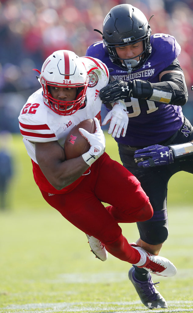 Nebraska's Devine Ozigbo, left, is tackled by Northwestern's Samdup Miller during the second half of an NCAA college football game Saturday, Oct. 13, 2018, in Evanston, Ill. (AP Photo/Jim Young)