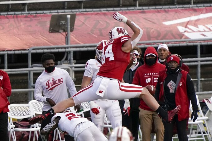 Wisconsin's Jake Ferguson leaps over Indiana defensive back Jaylin Williams during the first half of an NCAA college football game Saturday, Dec. 5, 2020, in Madison, Wis. (AP Photo/Morry Gash)