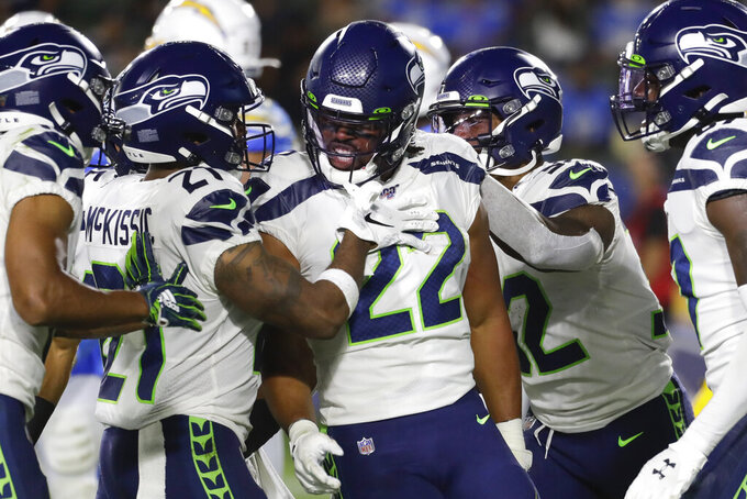 Seattle Seahawks running back C.J. Prosise (22) celebrates his touchdown against the Los Angeles Chargers during the first half of an NFL preseason football game Saturday, Aug. 24, 2019, in Carson, Calif. (AP Photo/Alex Gallardo)