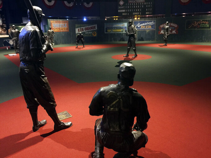 In this undated photo provided by the Negro Leagues Baseball Museum, the Field of Legends at the Negro Leagues Baseball Museum is viewed in Kansas City, Mo. The display features 10 life-size statues of Negro League greats cast in position as if they were playing a game. Former President Barack Obama tipped his cap. So did three other former presidents and a host of prominent civil rights leaders, entertainers and sports legends in a virtual salute to the 100-year anniversary of the founding of baseball's Negro Leagues. The campaign launched Monday, June 29, 2020, with photos and videos from, among others, Hank Aaron, Rachel Robinson Derek Jeter, Colin Powell, Michael Jordan, Obama and presidents George W. Bush, Bill Clinton and Jimmy Carter at tippingyourcap.com. (Negro Leagues Baseball Museum via AP)