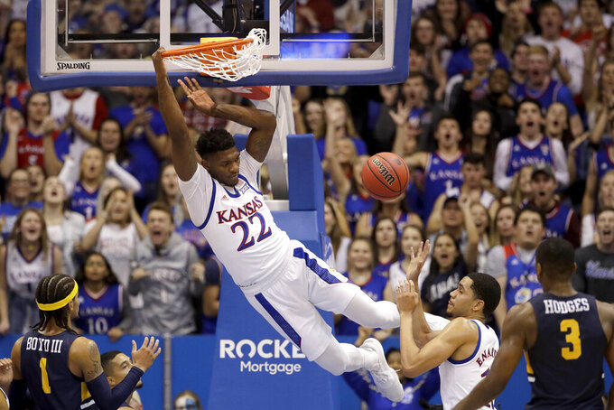 Kansas forward Silvio De Sousa (22) dunks the ball during the second half of an NCAA college basketball game against East Tennessee State Tuesday, Nov. 19, 2019, in Lawrence, Kan. Kansas won 75-63. (AP Photo/Charlie Riedel)