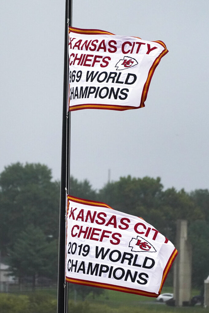 Super Bowl flags fly outside Arrowhead Stadium before an NFL football game between the Kansas City Chiefs and the Houston Texans Thursday, Sept. 10, 2020, in Kansas City, Mo. (AP Photo/Charlie Riedel)