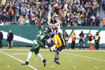 Pittsburgh Steelers wide receiver JuJu Smith-Schuster (19) and New York Jets cornerback Brian Poole (34) reach for the ball in the second half of an NFL football game, Sunday, Dec. 22, 2019, in East Rutherford, N.J. (AP Photo/Adam Hunger)