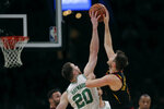 Boston Celtics forward Gordon Hayward (20) blocks a shot by Cleveland Cavaliers guard Matthew Dellavedova, right, during the first half of an NBA basketball game in Boston, Monday, Dec. 9, 2019. Hayward returned to play after breaking his left hand in early November. (AP Photo/Charles Krupa)