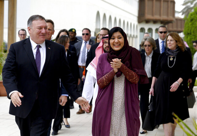FILE - In this Feb. 20, 2020, file photo, U.S. Secretary of State Mike Pompeo, left, walks with Saudi ambassador to the United States Princess Reema Bint Bandar at Princess Reema's Palace in Riyadh. With Joe Biden re-emerging as the front-runner in the Democratic presidential race, Saudi Arabia's ambassador to the United States dismisses Biden's description of the kingdom as a