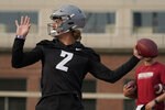 Washington State quarterback Cammon Cooper throws a pass on the first day of NCAA college football practice, Friday, Aug. 6, 2021, in Pullman, Wash. (AP Photo/Ted S. Warren)