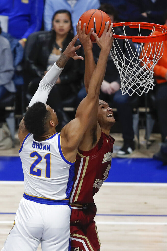 Boston College's Steffon Mitchell, right, shoots as Pittsburgh's Terrell Brown (21) defends during the first half of an NCAA college basketball game, Wednesday, Jan. 22, 2020, in Pittsburgh. (AP Photo/Keith Srakocic)