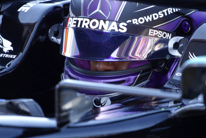 Mercedes driver Lewis Hamilton of Britain sits in his car after he clocked the fastest time in the qualifying for the Spanish Formula One Grand Prix at the Barcelona Catalunya racetrack in Montmelo, just outside Barcelona, Spain, Saturday, May 8, 2021. The Spanish Grand Prix will be held on Sunday. (AP Photo/Emilio Morenatti, Pool)