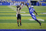 Vanderbilt wide receiver Cam Johnson (7) catches the ball and scores a touchdown during the second half of an NCAA college football game against Kentucky, Saturday, Nov. 14, 2020, in Lexington, Ky. (AP Photo/Bryan Woolston)
