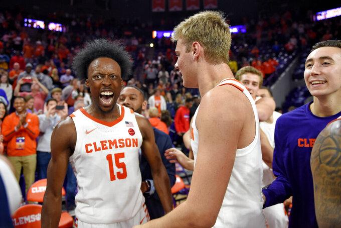 Clemson's John Newman lll, left, celebrates with Parker Fox after an NCAA college basketball game against Duke Tuesday, Jan. 14, 2020, in Clemson, S.C. Clemson won 79-72. (AP Photo/Richard Shiro)