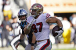 San Francisco 49ers defensive end Nick Bosa runs with the ball after making an interception during the second half of an NFL football game against the Carolina Panthers in Santa Clara, Calif., Sunday, Oct. 27, 2019. (AP Photo/Tony Avelar)