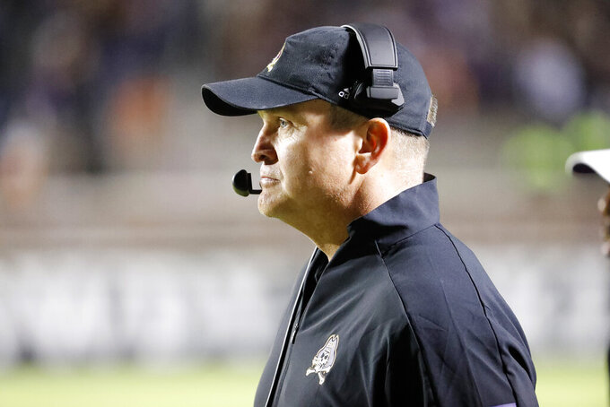 East Carolina head coach Mike Houston looks from the sidelines against Cincinnati during the first half of an NCAA college football game in Greenville, N.C., Saturday, Nov. 2, 2019. Houston opens his second season with the Pirates on Saturday, Sept. 26, 2020 against No. 13 UCF. (AP Photo/Karl B DeBlaker)