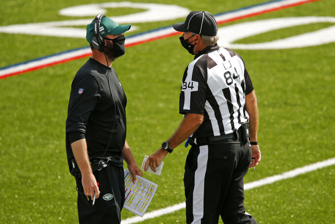 New York Jets head coach Adam Gase, left, talks with linesman Mark Steinkerchner during the second half of an NFL football game against the Buffalo Bills in Orchard Park, N.Y., Sunday, Sept. 13, 2020. (AP Photo/Jeffrey T. Barnes)