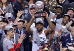 Toronto Raptors' Kawhi Leonard hoists the trophy after the Raptors defeated the Milwaukee Bucks 100-94 in Game 6 of the NBA basketball playoffs Eastern Conference finals Saturday, May 25, 2019, in Toronto. The Raptors advanced to the NBA Finals. (Frank Gunn/The Canadian Press via AP)