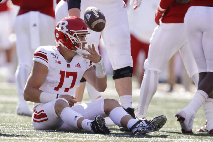 Rutgers quarterback Johnny Langan (17) tosses the football to an official after getting sacked during the second half of an NCAA college football game against Indiana, Saturday, Oct. 12, 2019, in Bloomington, Ind. Indiana won 35-0. (AP Photo/Darron Cummings)