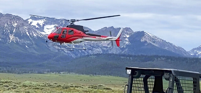 This photo from video by David Coyner shows a low-flying helicopter harassing a work crew building a public trail on an easement crossing private land that connects the popular tourist destinations of Redfish Lake and Stanley in central Idaho, according to the U.S. Department of Justice.  The U.S. Department of Justice on Wednesday, June 24, 2020 asked a federal judge to prohibit the harassment during work on the trail that's at the center of a federal lawsuit.(David Coyner via AP)