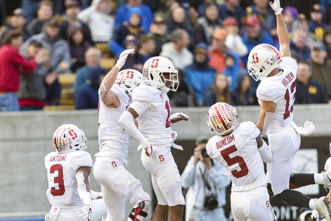 Stanford cornerback Paulson Adebo (11) celebrates after intercepting a pass to the end zone by California quarterback Chase Garbers in the fourth quarter of a football game in Berkeley, Calif., Saturday, Dec. 1, 2018. (AP Photo/John Hefti)