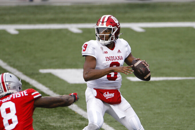 Indiana quarterback Michael Penix looks for an open receive against Ohio State during the first half of an NCAA college football game Saturday, Nov. 21, 2020, in Columbus, Ohio. (AP Photo/Jay LaPrete)