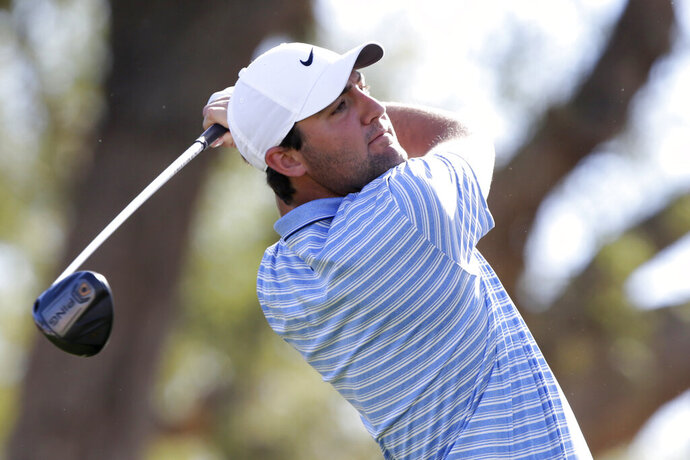 Scott Scheffler follows through on the third tee during the final round of The American Express golf tournament on the Stadium Course at PGA West in La Quinta, Calif., Sunday, Jan. 19, 2020. (AP Photo/Alex Gallardo)