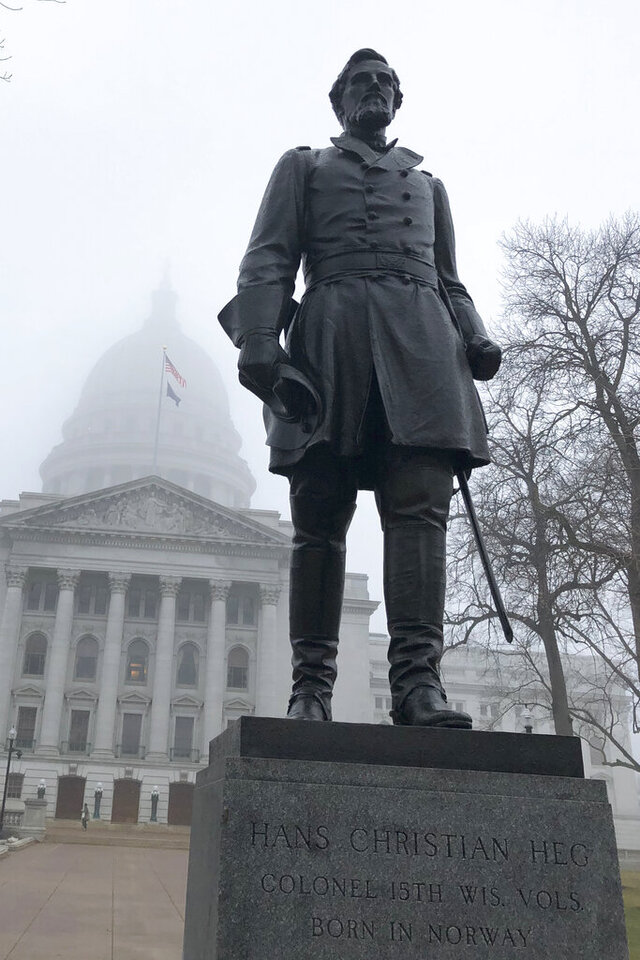 A statue of Civil War hero Hans Christian Heg is seen on March 11, 2020, outside the Wisconsin state Capitol, in Madison, Wis. The Wisconsin abolitionist's descendants are imploring state officials to repair and reinstall the man's statue outside the state Capitol after demonstrators ripped it down during a wild night of protests against police racism last month. (AP Photo/Scott Bauer)