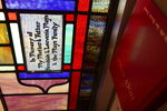 This Jan 2. 2021 photo shows the stained-glass windows of Old Mount Zion Baptist Church  in South Carolina.  Each dedicated in memory of families and members throughout the year, including the family of civil rights leader Benjamin E. Mays. (Damian Dominguez/The Index-Journal via AP)