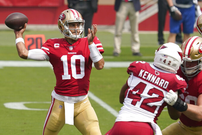 San Francisco 49ers quarterback Jimmy Garoppolo (10) passes against the Arizona Cardinals during the first half of an NFL football game in Santa Clara, Calif., Sunday, Sept. 13, 2020. (AP Photo/Tony Avelar)