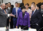 IOC member John Coates, front right, and Tokyo Governor Yuriko Koike, center, attend the Four-Party Representative Meeting in Tokyo Friday, Nov. 1, 2019. Next year's Olympic marathons and race walks will be run in the northern city of Sapporo as the IOC has followed through with a controversial plan to move from Tokyo to the cooler northern city. (Kimimasa Mayama /Pool Photo via AP)