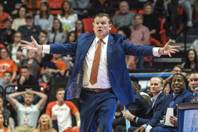 Illinois' head coach Brad Underwood reacts to a call from the sideline against Iowa in the second half of an NCAA college basketball game Sunday, March 8, 2020, in Champaign, Ill. (AP Photo/Holly Hart)