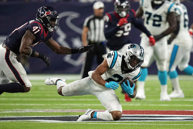 Carolina Panthers wide receiver DJ Moore (2) catches a pass as Houston Texans linebacker Zach Cunningham (41) defends during the second half of an NFL football game Thursday, Sept. 23, 2021, in Houston. (AP Photo/Eric Christian Smith)