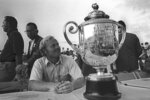 FILE - PGA championship winner  Jack Nicklaus smiles at the trophy after the golf tournament in Palm Beach Gardens, Fla., in this Feb. 28, 1971, file photo. It was the last time the event was held in February. (AP Photo/File)