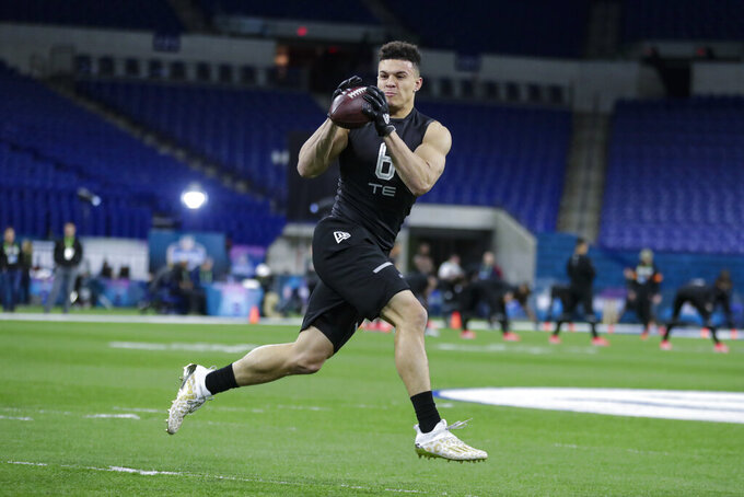 Purdue tight end Brycen Hopkins runs a drill at the NFL football scouting combine in Indianapolis, Thursday, Feb. 27, 2020. (AP Photo/Michael Conroy)
