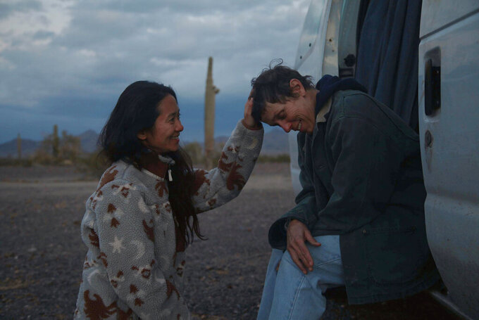 "FILE - In this file photo, Director Chloe Zhao, left, appears with actress Frances McDormand on the set of ""Nomadland.""  ""Nomadland"" has won four prizes, including best picture, at the British Academy Film Awards on Sunday, April 11, 2021. The film's director, Chloe Zhao, became only the second woman to win the best director trophy, and star Frances McDormand was named best actress. ""Nomadland"" also took the cinematography prize on Sunday. Emerald Fennell's revenge comedy ""Promising Young Woman"" was named best British film, while the best actor trophy went to 83-year-old Anthony Hopkins for playing a man grappling with dementia in ""The Father."" An event that was criticized in the recent past with the label #BAFTAsSoWhite rewarded a diverse group of talents, during a pandemic-curbed ceremony at London's Royal Albert Hall. (Searchlight Pictures via AP, FIle)"