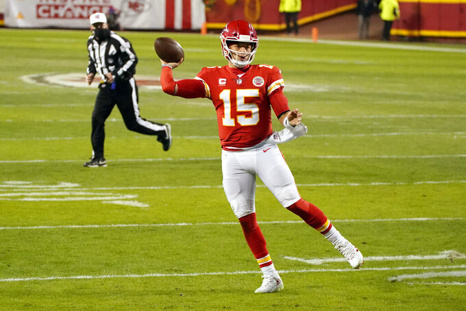 Kansas City Chiefs quarterback Patrick Mahomes throws a pass during the second half of the AFC championship NFL football game against the Buffalo Bills, Sunday, Jan. 24, 2021, in Kansas City, Mo. (AP Photo/Charlie Riedel)