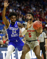 Houston's Corey Davis Jr. (5) heads to the basket as Georgia State's Devin Mitchell (24) defends during the second half of a first round men's college basketball game in the NCAA Tournament Friday, March 22, 2019, in Tulsa, Okla. (AP Photo/Jeff Roberson)