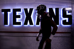 Houston Texans quarterback Deshaun Watson (4) makes his way to the field before an NFL wild-card playoff football game against the Buffalo Bills Saturday, Jan. 4, 2020, in Houston. (AP Photo/Eric Christian Smith)