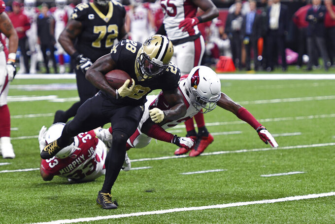 New Orleans Saints running back Latavius Murray (28) carries for a touchdown against Arizona Cardinals defensive back Jalen Thompson in the first half of an NFL football game in New Orleans, Sunday, Oct. 27, 2019. (AP Photo/Bill Feig)