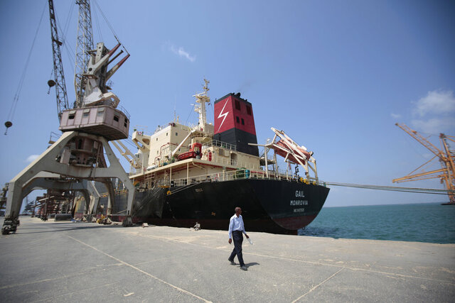 FILE - In this Sept. 29, 2018 file photo, a cargo ship is docked at the port, in Hodeida, Yemen. U.N. Special Envoy for Yemen Martin Griffiths  released a statement Thursday, Oct. 8, 2020 condemning the recent clashes in Yemen's strategic port city of Hodeida, which has so far left dozens of casualties, and urged the country's warring parties to immediately stop the fighting. Since Saturday, clashes have flared up between Yemen's Houthi rebels and government forces south of the port in Hodeida, which handles about 70% of Yemen's commercial and humanitarian imports. (AP Photo/Hani Mohammed, File)