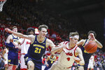 Michigan guard Franz Wagner (21, left) and Rutgers guard Paul Mulcahy (4) chase after a loose ball during the second half of an NCAA college basketball game, Wednesday, Feb. 19, 2020 in Piscataway, N.J. (Andrew Mills/NJ Advance Media via AP)
