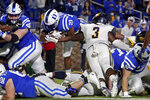 Duke running back Mataeo Durant (21) dives past North Carolina A&T linebacker Kyin Howard (3) for a touchdown during the first half of an NCAA college football game in Durham, N.C., Friday, Sept. 10, 2021. (AP Photo/Chris Seward)
