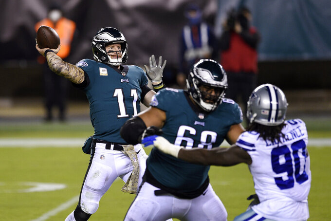Philadelphia Eagles' Carson Wentz passes during the second half of an NFL football game against the Dallas Cowboys, Sunday, Nov. 1, 2020, in Philadelphia. (AP Photo/Derik Hamilton)